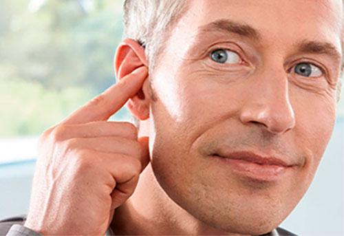 Как настроить слуховой аппарат